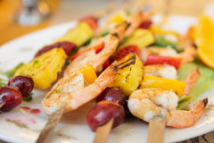 Prawns grilled with fruits. Cajun style dish Stock Photography
