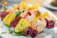 Prawns grilled with fruits. Cajun style dish Royalty Free Stock Photos