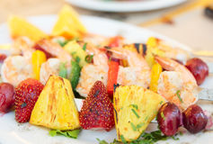 Prawns grilled with fruits Stock Images