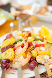Prawns grilled with fruits. Cajun style dish Royalty Free Stock Images