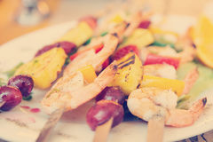 Prawns grilled with fruits, toned Royalty Free Stock Photos