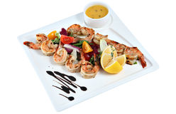 Prawns grilled with vegetable on square ceramic serving dish iso Royalty Free Stock Images
