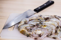 Prawns and knife Royalty Free Stock Photography