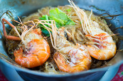 Prawns ovened cellophane noodle or glass noodles and herbs. Chinese food in Thai style. Thai famous local food. Thai recommend menu for tourist Royalty Free Stock Photos