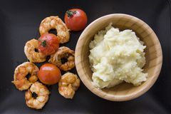 Prawns  with potato dumplings on black Royalty Free Stock Photo