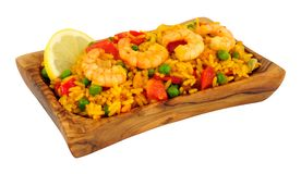 Prawns And Rice In An Olive Wood Serving Dish stock images