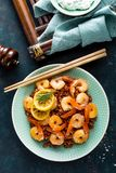 Prawns roasted on grill and boiled brown rice on plate. Grilled shrimps, prawns with rice. Seafood. Asian cuisine. Top view royalty free stock photography