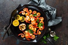 Prawns Roasted On Grill Frying Pan With Lemon And Garlic. Grilled Shrimps, Prawns. Seafood. Top View Royalty Free Stock Photo