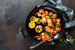 Prawns Roasted On Grill Frying Pan With Lemon And Garlic. Grilled Shrimps, Prawns. Seafood. Top View Royalty Free Stock Image
