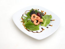 Prawns with salad. Pawns with salad on withe plate Royalty Free Stock Photos
