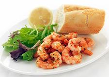 Prawns with Salad, bread and lemon Stock Images