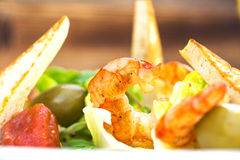 Prawns salad on a wooden background Stock Photography