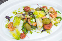 Prawns salad on a wooden background Royalty Free Stock Images