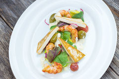 Prawns salad on a wooden background Royalty Free Stock Photography