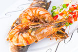 Prawns with sea bass fish. Stock Images