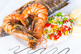 Prawns with sea bass fish. Royalty Free Stock Photos