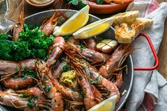 Close view of tiger prawn shrimps roasted with lemon garlic and wine Stock Image