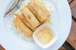 Prawns Spring Rolls with salad and sweet plum dipping sauce of Thai style on table. Royalty Free Stock Photo