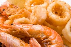 Prawns and squid. A plate of fried prawns and calamari Royalty Free Stock Images
