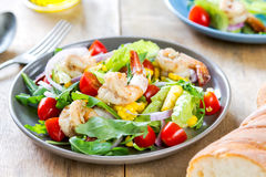 Prawns with sweet corn and rocket salad Stock Image