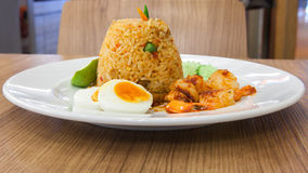 Prawns Sweet Pork Fried Rice with Chilli Sauce. On the table Stock Images