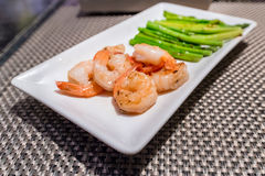 Prawns teppanyaki with asparagus. Japanese foods Stock Photography