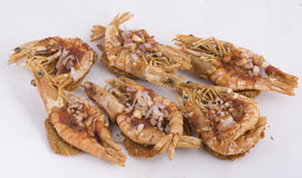Prawns topped spicy split pea patties Royalty Free Stock Photos