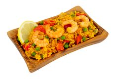 Prawns And Rice In An Olive Wood Serving Dish stock photography