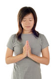 Pray. Gesture of Asian woman, closing eyes and thinking on white background Stock Image