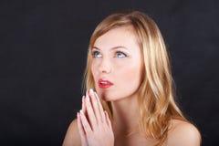 Pray. The woman prays in a shadow Stock Photos