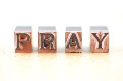 Pray. Word pray spelled out in letterpress letters Royalty Free Stock Photo