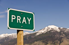 Pray. Sign for the town of Pray, Montana.  Use it for religious or spiritual themes Stock Images