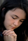 Pray. Teen girl praying very upset and sad depressed Royalty Free Stock Images