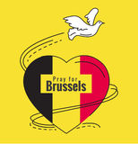 Pray for Brussels. Dove and Heart of Belgium flag color. Stock Photo