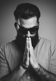 Pray of brutal hipster wearing sunglasses Royalty Free Stock Image