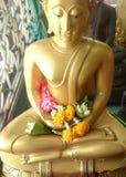 Pray of Buddha image. Flower on hand for pray of buddha image, songkran festival Royalty Free Stock Photography