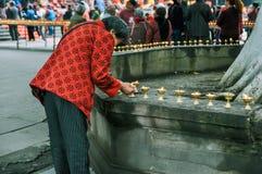 Pray and burn incense, Flame oil lamp. stock photos