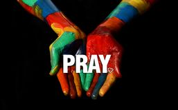 Pray concept on Multi Colors Painted hand.  Stock Photography