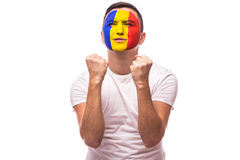 Pray and cry emotions for Romanian football fan in game  of Romania national team. On white background. European football fans concept Stock Image