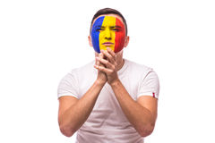 Pray and cry Romanian football fan in game  of Romania national team Royalty Free Stock Photography