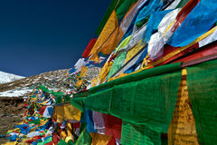 Pray Flags,Nyingchi,Tibet. Tibet colorful prayer flags with snowy mountain in the background. Nyingchi,Tibet,China Royalty Free Stock Photo