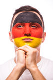 Pray for Germany. Face portrait German football fan pray for national team Stock Photos