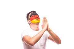 Pray for Germany. German football fan pray for national team Royalty Free Stock Photo