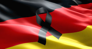 Pray for germany, waving germany country flag color background with black ribbon Royalty Free Stock Image