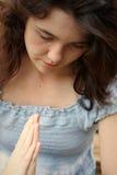 Pray girl stock images