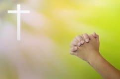Pray for God`s blessing Cross on natural background blurring. Pray for God`s blessing Cross on natural background blurring stock photos