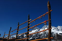 Pray for happiness. People hangs up windbell , prays for happiness under the snow-capped mountain. Li Jiang Yunnan China Royalty Free Stock Image