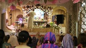 Pray of Hare Krishna followers at the festive ceremony stock video footage