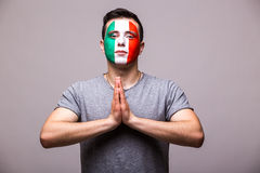 Pray for Italy. Italian football fan pray for game Italy national team on grey background. Stock Photos