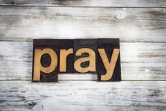 Pray Letterpress Word on Wooden Background Royalty Free Stock Images